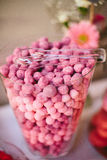 Ombre Candy Buffet Table. A vase filled with ombre pink candies at a love themed wedding reception candy dessert buffet table Stock Images