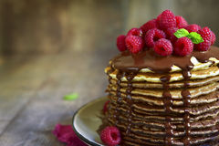 Ombre chocolate pancakes with fresh raspberry and chocolate sauc Royalty Free Stock Photo