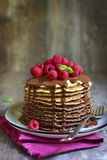 Ombre chocolate pancakes with fresh raspberry and chocolate sauc. E on a vintage plate on rustic wooden background Royalty Free Stock Photos