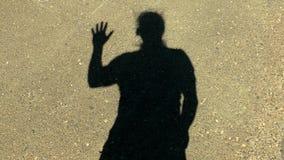 Ombre d'homme sur des expressions de mur clips vidéos