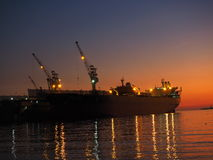Ombre de mer de coucher du soleil de fond Photographie stock