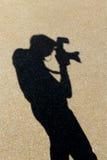 Ombre de photographe sur le rez-de-chaussée Photographie stock