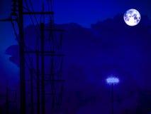 ombre de pleine lune de nuage électrique de ligne électrique et de tempête Photos stock