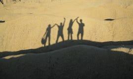 Ombre della gente sulla sabbia Fotografia Stock