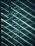 Ombre des abat-jour sur le mur Images stock