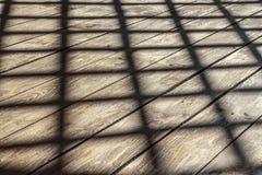 Ombre sur le plancher image libre de droits
