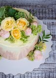 Ombre wedding cake decorated with roses and some greenery. An ombre wedding cake decorated with roses and some greenery Royalty Free Stock Photo