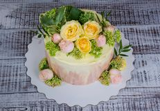 Ombre wedding cake decorated with roses and some greenery. An ombre wedding cake decorated with roses and some greenery Royalty Free Stock Photos