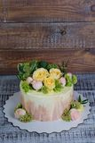 Ombre wedding cake decorated with roses and some greenery. An ombre wedding cake decorated with roses and some greenery Stock Image