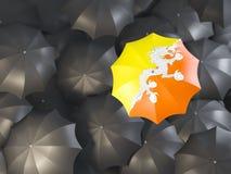 Ombrello con la bandiera del Bhutan Immagini Stock