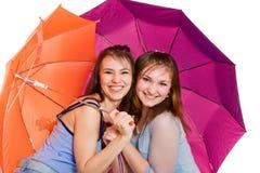 Ombrello del lwith delle due ragazze Fotografie Stock Libere da Diritti