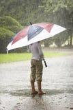 Ombrello nella pioggia Fotografie Stock