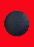 Ombrello su colore rosso Immagine Stock Libera da Diritti
