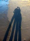 Ombres de Silouette dans le sable Photographie stock