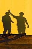 Ombres de travailleurs de la construction Photos libres de droits