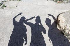 Ombres de trois amis Photos stock