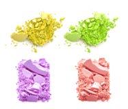Ombretti schiacciati multicolori isolati su fondo bianco Immagine Stock