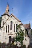 Omdanad kyrka i Sighisoara, Rumänien Arkivfoton