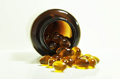 Omega-3 capsules. Rice bran and germ oil capsules - source of omega 3 Stock Photo