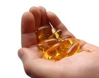 Omega-3 capsules in hand Royalty Free Stock Photos