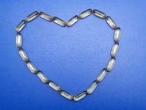 Omega 3 capsules heart shape Royalty Free Stock Photography
