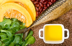 Omega-3 fatty acid sources. Natural sources of omega 3 fatty acids: flaxseeds, fat fish, field lettuce, pumpkin and pumpkin seeds, olive oil and kidney beans Royalty Free Stock Photography