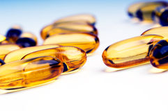 Omega 3 Fish Oil Capsule. Bright yellow Omega 3 Fish Oil Capsules with shallow focus Royalty Free Stock Photo