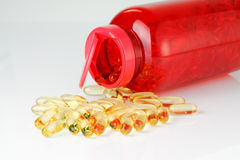 Omega 3 fish oil capsules with red bottle Royalty Free Stock Image