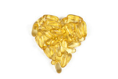 Omega 3 heart. Fish oil capsules arranged in heart shape Stock Photos