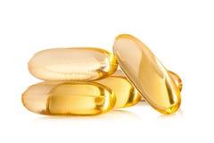 Omega 3 capsules d'huile de poisson sur le fond blanc Photographie stock libre de droits