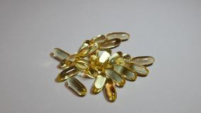 Omega3 Extra capsules from Fish Oil on grey background. stock video