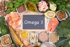 Omega 3 fatty acids food sources. Food sources of Omega 3 fatty acids such as grains, fruit, vegetables and fish, top view Stock Image
