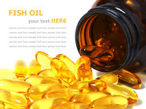 Omega 3 fish oil capsules spilling out of a bottle Royalty Free Stock Photos