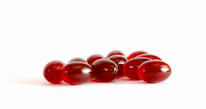 Omega 3 krill capsules. Picture of an omega 3 krill capsules Royalty Free Stock Photos