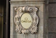 OMEGA logo på väggen Royaltyfria Bilder