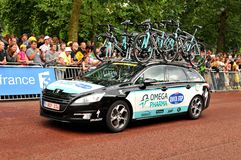 Omega Pharma team in the Tour de France. London, UK – July 7, 2014: The caravan of the Belgian team Omega Pharma-QuickStep arrive at The Mall, approaching the Royalty Free Stock Image