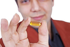 Omega pill holding hand Royalty Free Stock Photography