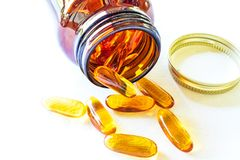 Omega 3 pills spreads on the table. stock photo