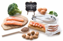Omega 3 rich foods. Collection of foods high in fatty acids omega 3 including seafood, vegetables and seeds royalty free stock photos