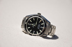 Omega Seamaster Planet Ocean wristwatch lying ona beach on Fraser Island, Australia Stock Photos