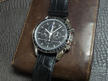 Omega Speedmaster with wallet Stock Photos