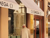 Omega. Store in munich with a man considering one of their watches stock photo