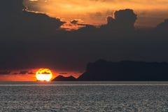 OMEGA SUNSET AT THE SEASIDE Royalty Free Stock Image
