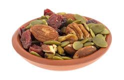 Omega 3 trail mix in an small clay bowl Stock Photo