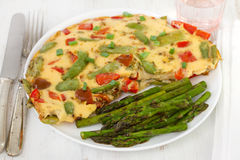 Omelet and asparagus Stock Image