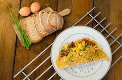 Omelet with bacon and cheese Stock Photography