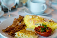 Omelet with Bacon Hash Browns and Broiled Tomato. A fresh Omelet of smoked salmon and cheese with Bacon Hash Browns and Broiled Tomato stock images