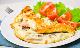 Omelet with bacon and mushrooms stock photo