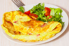 Omelet with bacon and salad Royalty Free Stock Images