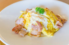 Omelet and bacon on white plate. Stock Images